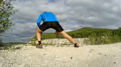 Man doing sit-ups outdoors in the mountains. Stock Footage