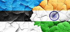 estonia flag with India flag on a grunge cracked wall - stock illustration