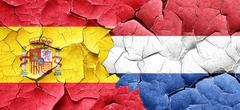 Spanish flag with Netherlands flag on a grunge cracked wall Stock Illustration