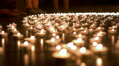 One Person Placing Candle to the Group of Candles Stock Footage