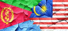 Eritrea flag with Malaysia flag on a grunge cracked wall - stock illustration