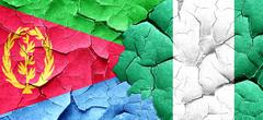 Eritrea flag with Nigeria flag on a grunge cracked wall - stock illustration
