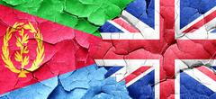 Eritrea flag with Great Britain flag on a grunge cracked wall Stock Illustration