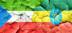 Equatorial guinea flag with Ethiopia flag on a grunge cracked wa Stock Illustration