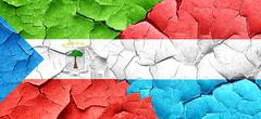 Equatorial guinea flag with Luxembourg flag on a grunge cracked - stock illustration