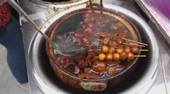 Pig Trotters and eggs in Ginger and Sweetened Vinegar - stock footage