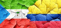 Equatorial guinea flag with Colombia flag on a grunge cracked wa - stock illustration