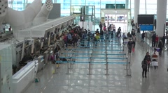 shenzhen airport,people waiting in the counter to get boarding pass - stock footage