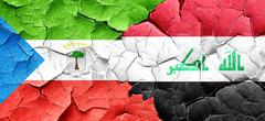 Equatorial guinea flag with Iraq flag on a grunge cracked wall - stock illustration