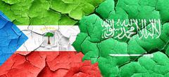 Equatorial guinea flag with Saudi Arabia flag on a grunge cracke - stock illustration