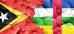 east timor flag with Central African Republic flag on a grunge c - stock illustration