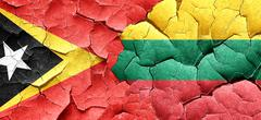 east timor flag with Lithuania flag on a grunge cracked wall - stock illustration