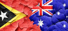 east timor flag with Australia flag on a grunge cracked wall - stock illustration