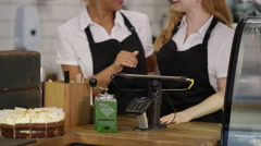 4K Portrait of friendly smiling workers standing behind counter in coffee shop Stock Footage