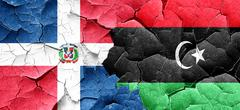 dominican republic flag with Libya flag on a grunge cracked wall - stock illustration