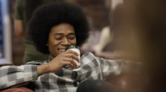 4K Portrait smiling hipster guy spending time with friends in city coffee shop.  Arkistovideo