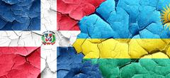 dominican republic flag with rwanda flag on a grunge cracked wal - stock illustration