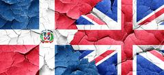Dominican republic flag with Great Britain flag on a grunge crac Stock Illustration