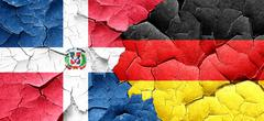 dominican republic flag with Germany flag on a grunge cracked wa - stock illustration