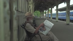Old Man Reading Latest News - stock footage