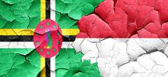 Dominica flag with Indonesia flag on a grunge cracked wall - stock illustration