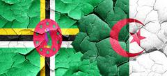 Dominica flag with Algeria flag on a grunge cracked wall - stock illustration