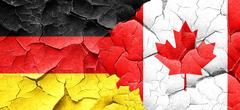 German flag with Canada flag on a grunge cracked wall Stock Illustration