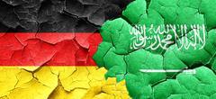 German flag with Saudi Arabia flag on a grunge cracked wall Stock Illustration