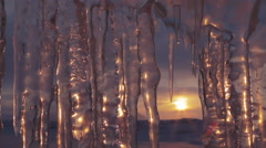 Setting sun is reflected in icicles. Time Lapse Stock Footage