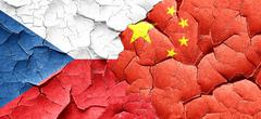czechoslovakia flag with China flag on a grunge cracked wall - stock illustration