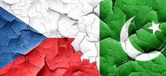 Czechoslovakia flag with Pakistan flag on a grunge cracked wall Stock Illustration