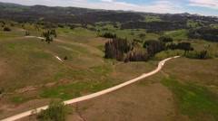 Aerial falling shot of high mountain pass in the spring Stock Footage