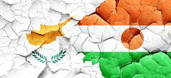 Cyprus flag with Niger flag on a grunge cracked wall - stock illustration