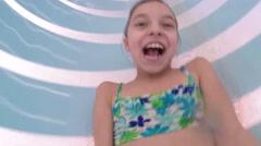 Happy little girl at aqua park Stock Footage