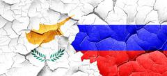 Cyprus flag with Russia flag on a grunge cracked wall Stock Illustration