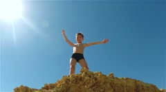 Boy on blue sky background Stock Footage