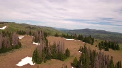Aerial moving shot of a high mountain pass in the spring Stock Footage