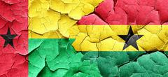 Guinea bissau flag with Ghana flag on a grunge cracked wall Stock Illustration