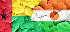 Guinea bissau flag with Niger flag on a grunge cracked wall Stock Illustration