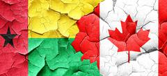 Guinea bissau flag with Canada flag on a grunge cracked wall - stock illustration