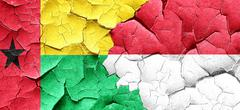 Guinea bissau flag with Indonesia flag on a grunge cracked wall Stock Illustration