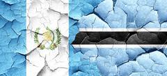Guatemala flag with Botswana flag on a grunge cracked wall Stock Illustration
