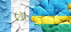 Guatemala flag with rwanda flag on a grunge cracked wall Stock Illustration