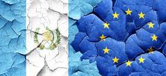 guatemala flag with european union flag on a grunge cracked wall - stock illustration