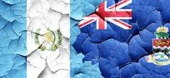 Guatemala flag with Cayman islands flag on a grunge cracked wall Stock Illustration