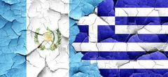 Guatemala flag with Greece flag on a grunge cracked wall Stock Illustration