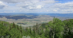 Beautiful valley from mountain forest overlook DCI 4K Stock Footage
