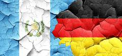Guatemala flag with Germany flag on a grunge cracked wall Stock Illustration