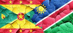 Grenada flag with Namibia flag on a grunge cracked wall - stock illustration