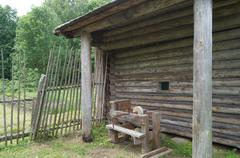 Russian village, wooden architecture, a device for pressing linen in the old day - stock photo